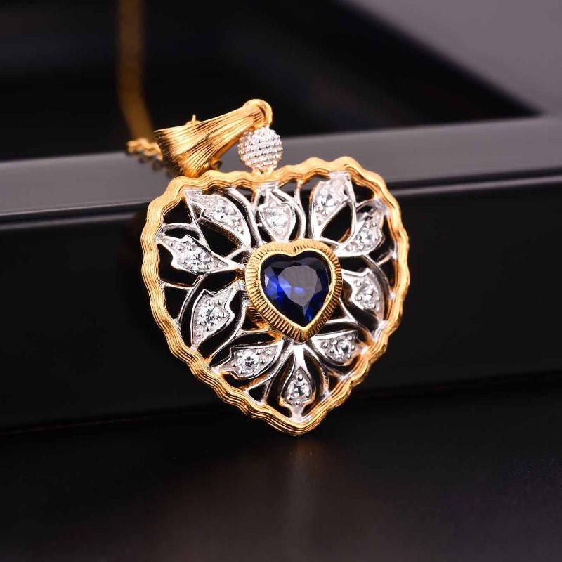 """Ciondolo """"Cuore della natura"""" fatto in argento placato oro con Zaffiro/Rubino"""